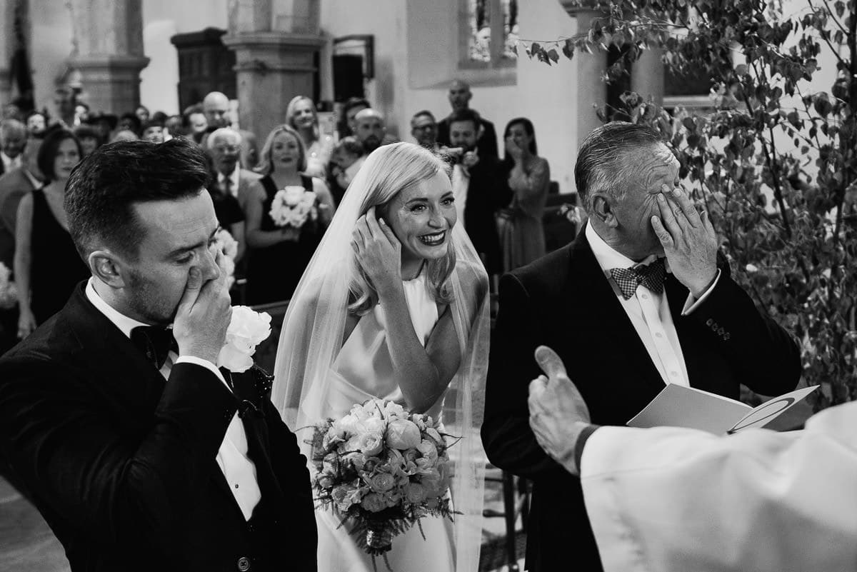 father of the bride and groom get emotional over the beautiful bride