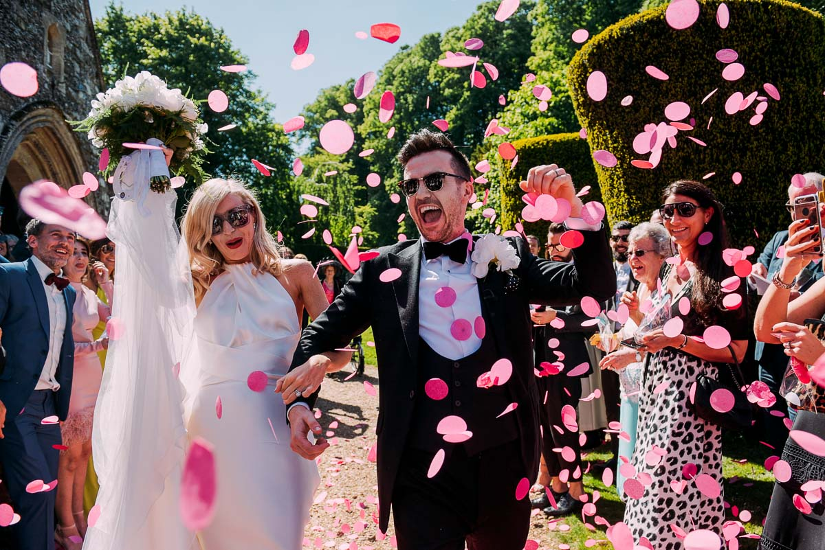 Alternative wedding photography bride and groom colourful pink confetti