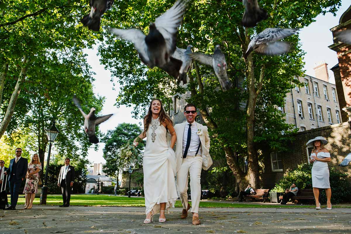 Alternative wedding couple run into pigeons in London
