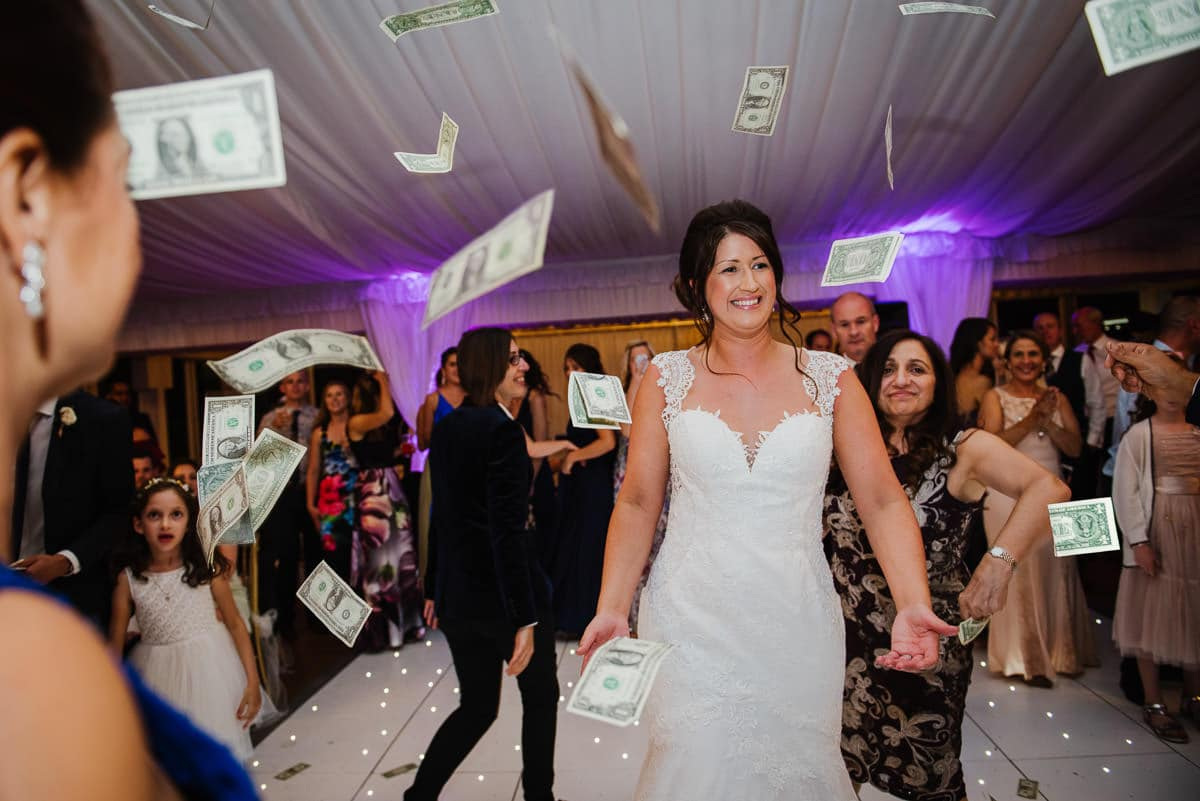 Traditional greek wedding ceremony throwing money
