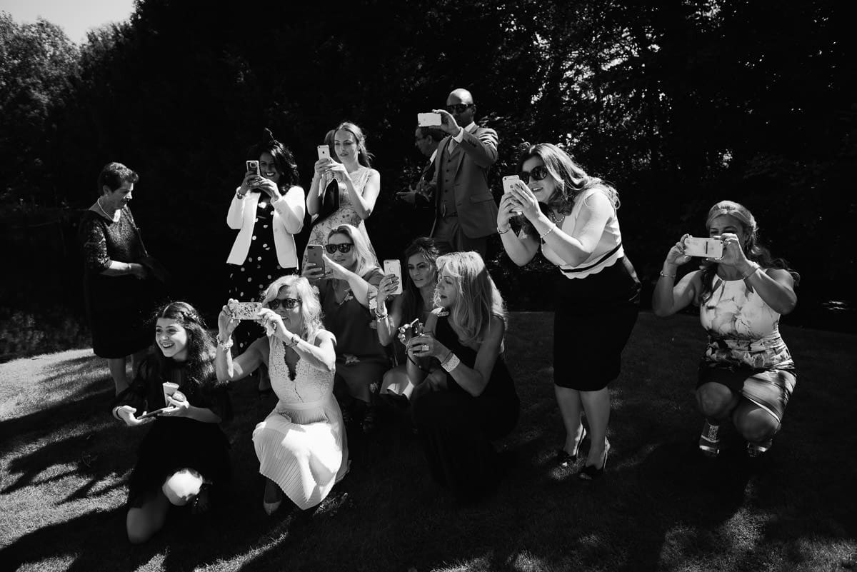 Wedding guests act as paparazzi