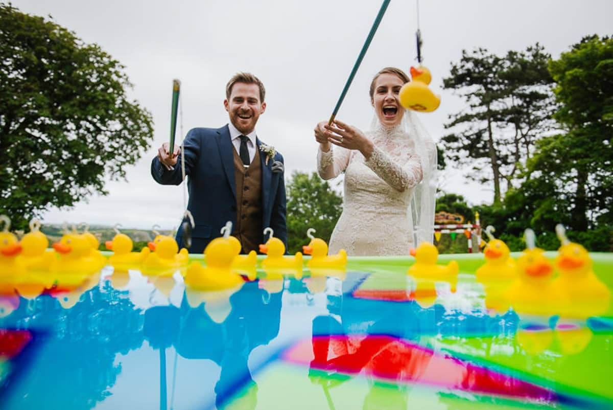 Bride and groom play wedding day games