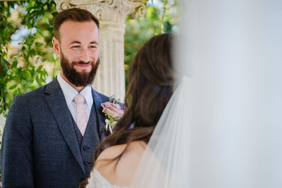 Groom smiling outside ceremony wedding photo