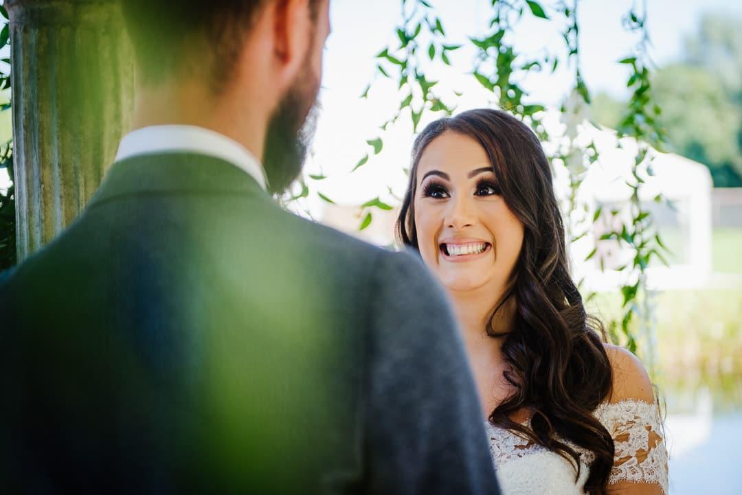 Bride smiling outside ceremony wedding photo