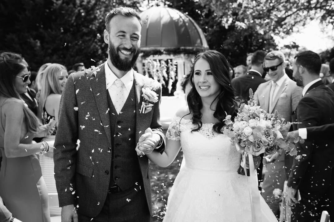 outside ceremony confetti wedding photo