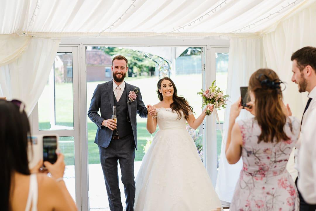 marquee wedding photo bride and groom entrance ardington house