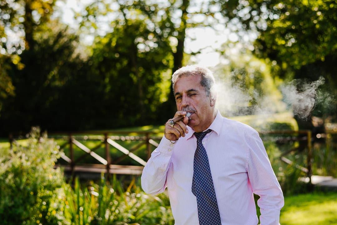 summer wedding smoking cigar ardington house oxon