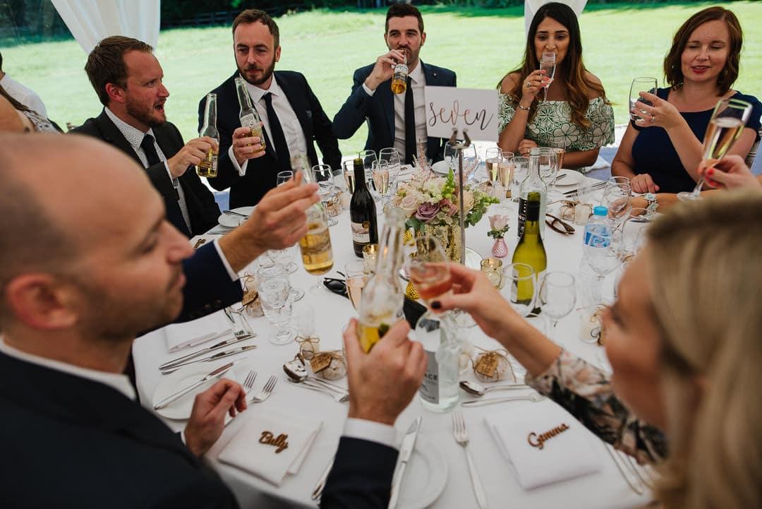 oxfordshire wedding photo guests at table ardington venue