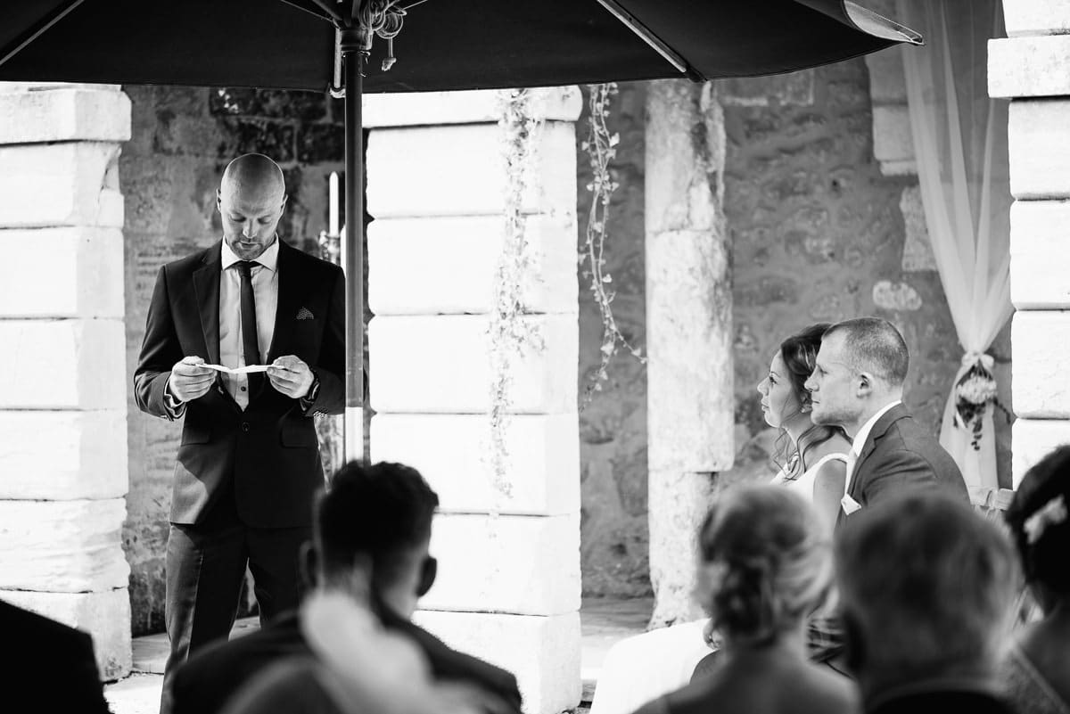 Guest reading a poem during wedding ceremony
