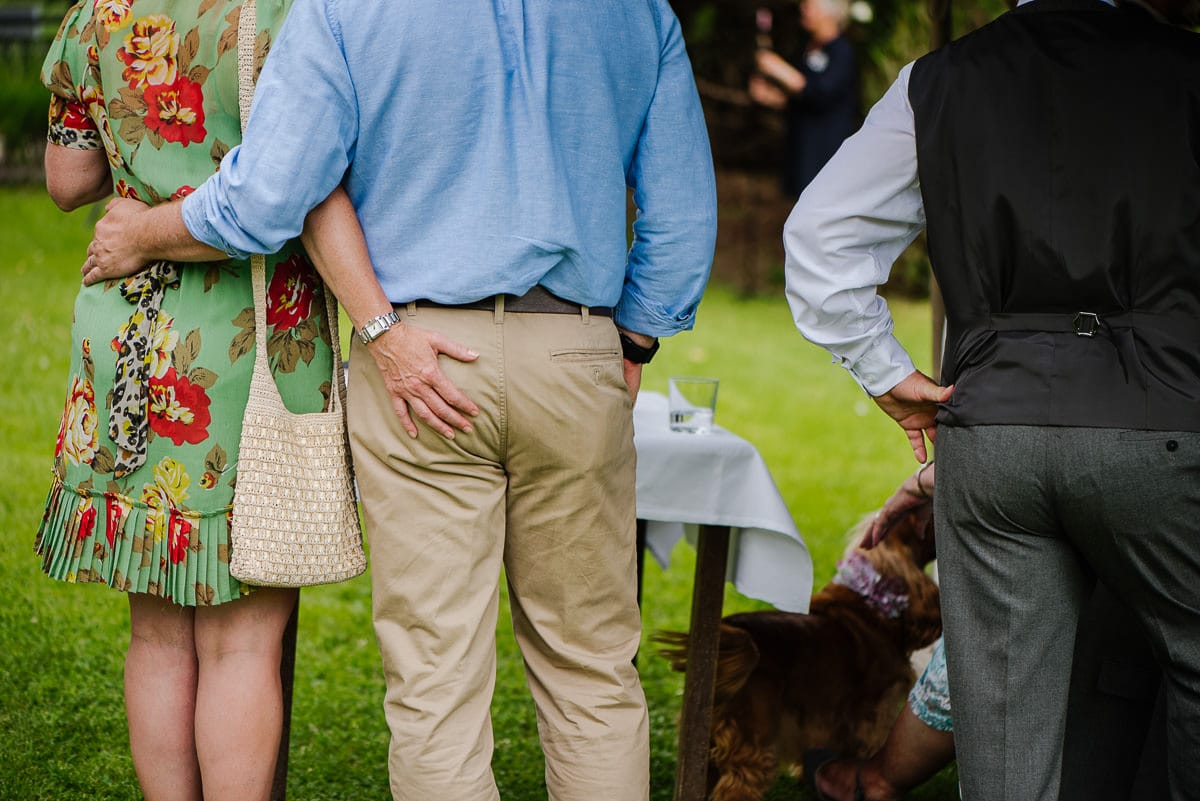 Guests with arms around each other during drinks reception