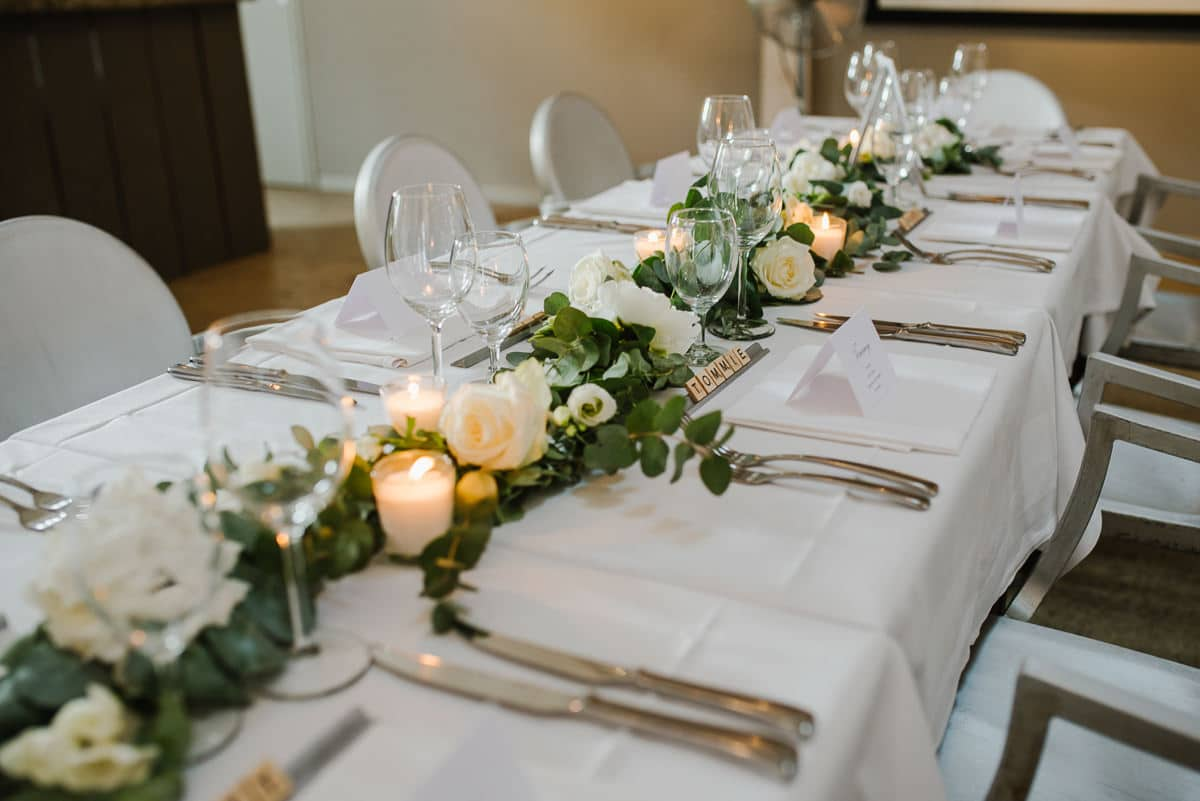 Table settings with flowers at chateau les merles wedding photo