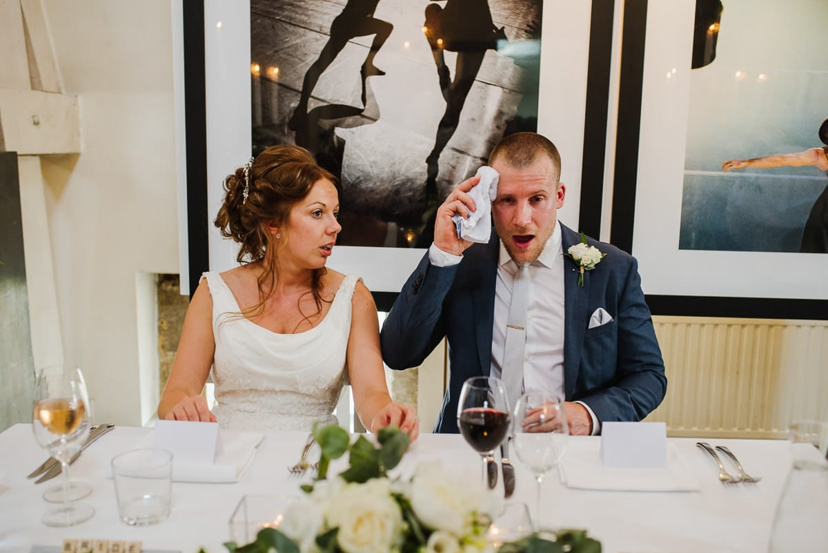 Wedding couple sat at top table during breakfast