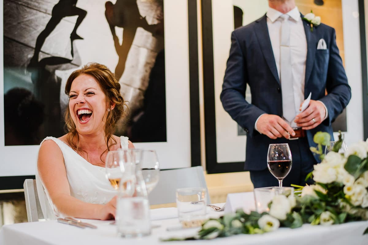 Bride laughing during speeches at chateau les merles in France