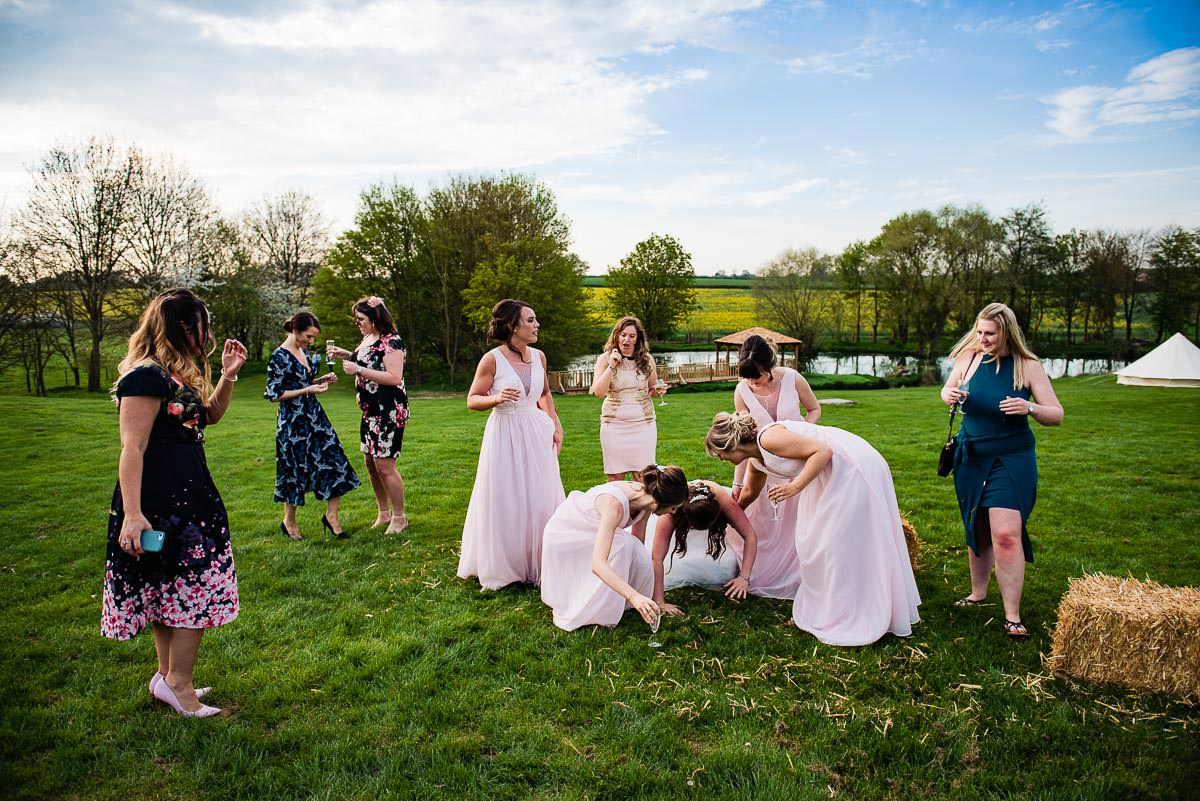 documentary style wedding photography captures bride tripping over