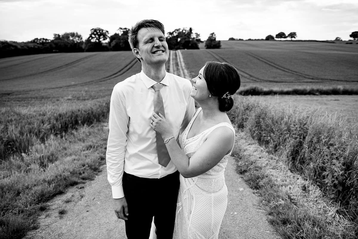 bride and groom laughing in the Worcestershire countryside