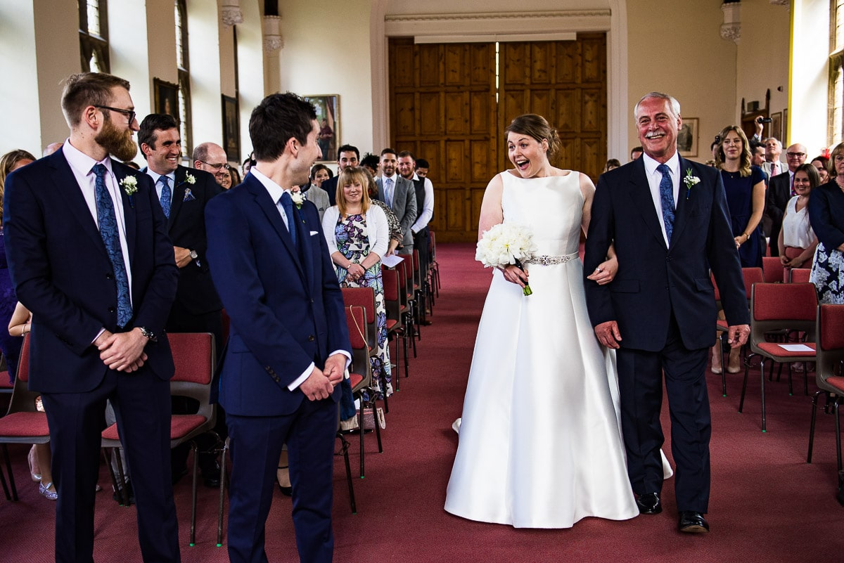 The moment bride and groom finally see each other as bride's father walks her down the aisle