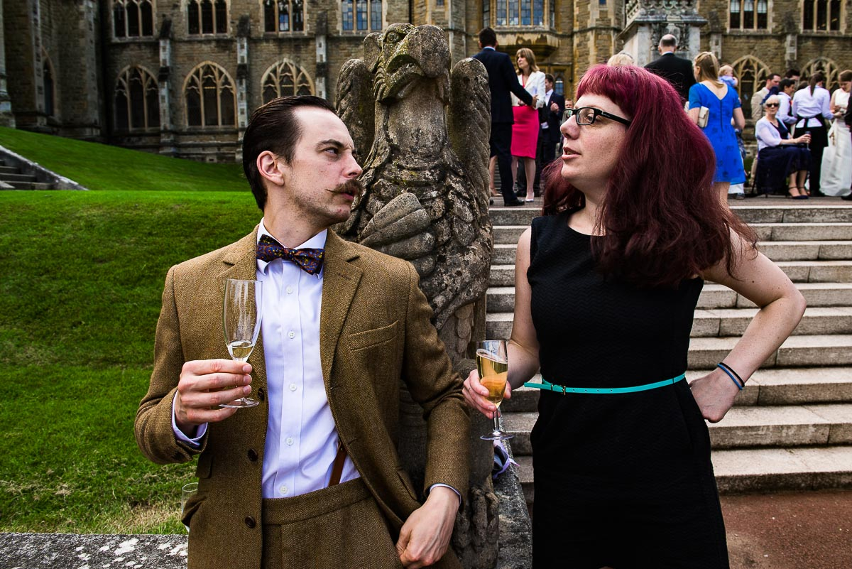 wedding guests strike a pose and  share a drink outside historic Worcestershire venue