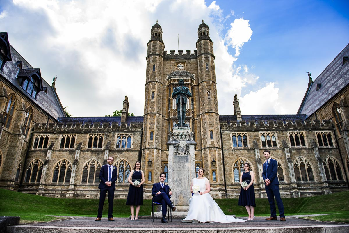 The bridal party pose outside Worcestershire's Malvern College Big School
