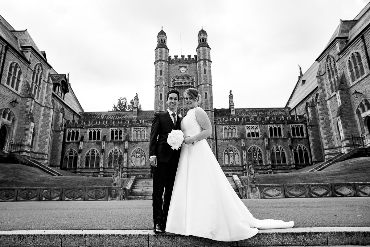 bride and groom posing outside historic Malvern college wedding chapel venue