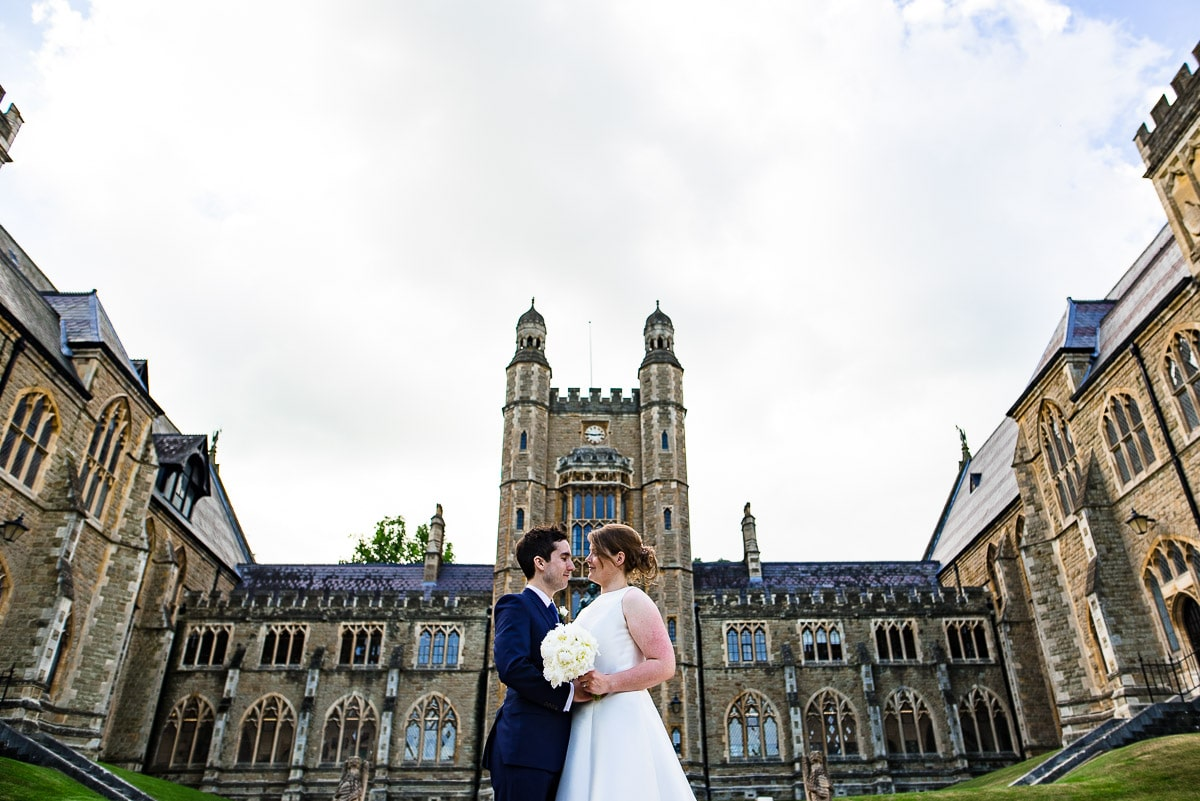 Bride and groom embrace outside Malvern college wedding photos