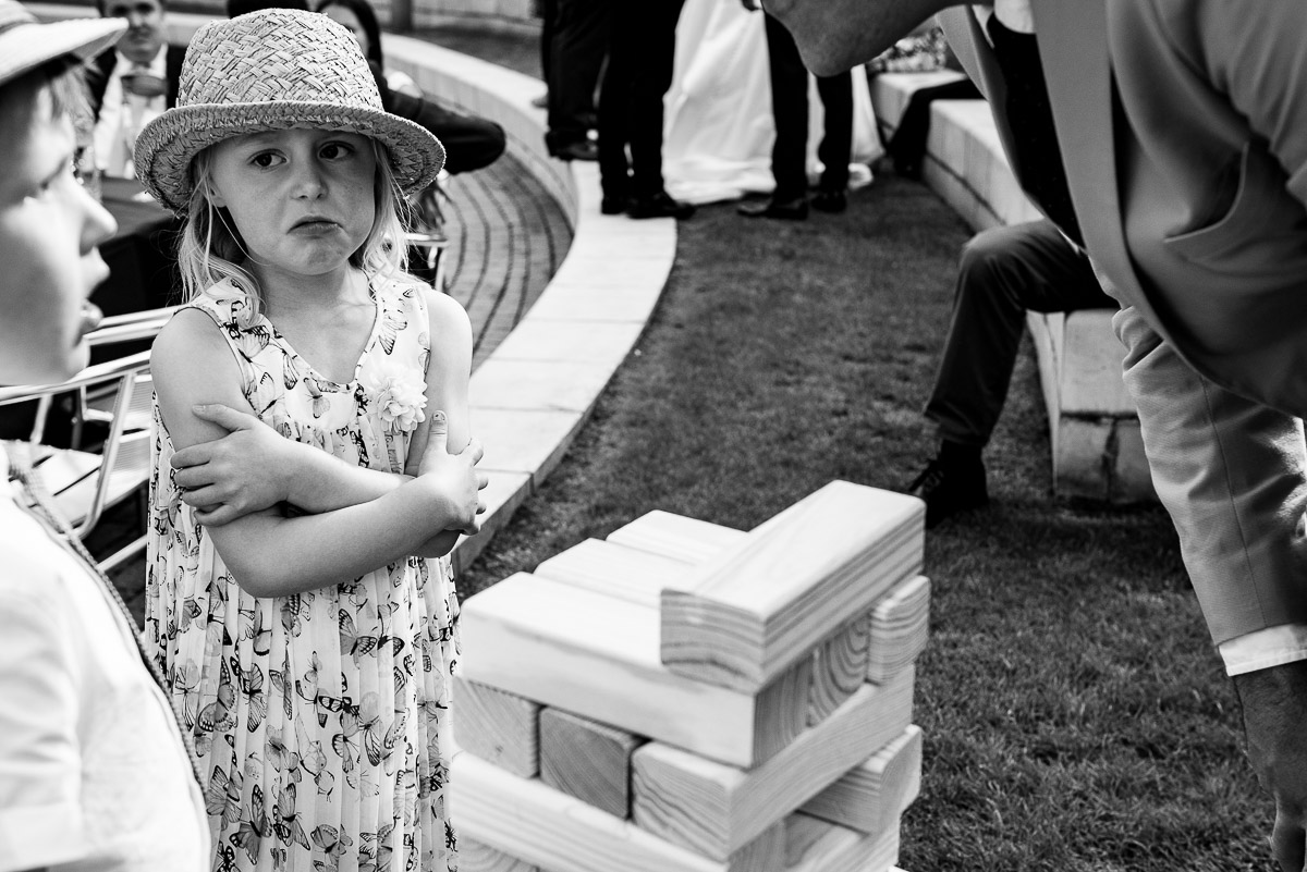candid image of grumpy young girl playing jenga