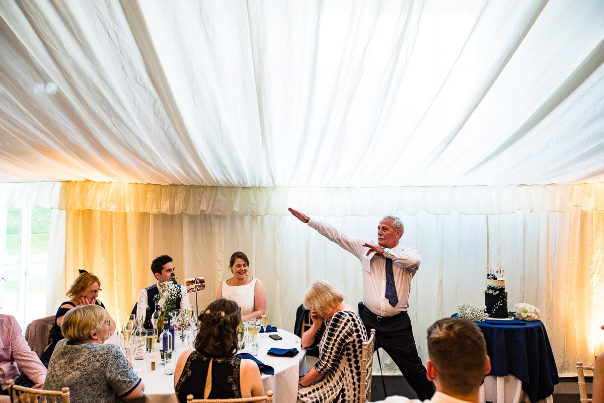 Father of the bride poses like Usain Bolt during his speech in marquee wedding
