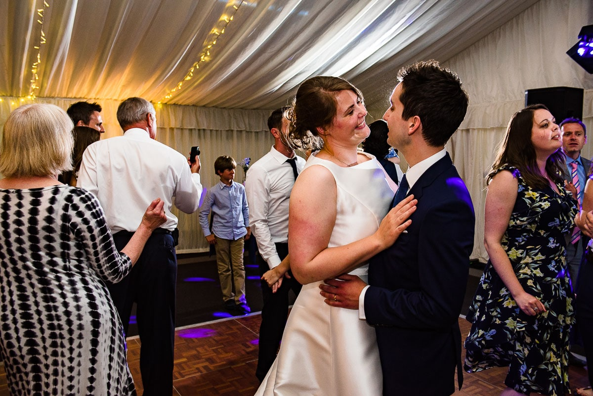 Bride and groom and wedding guests dance the night away in Malvern College venue