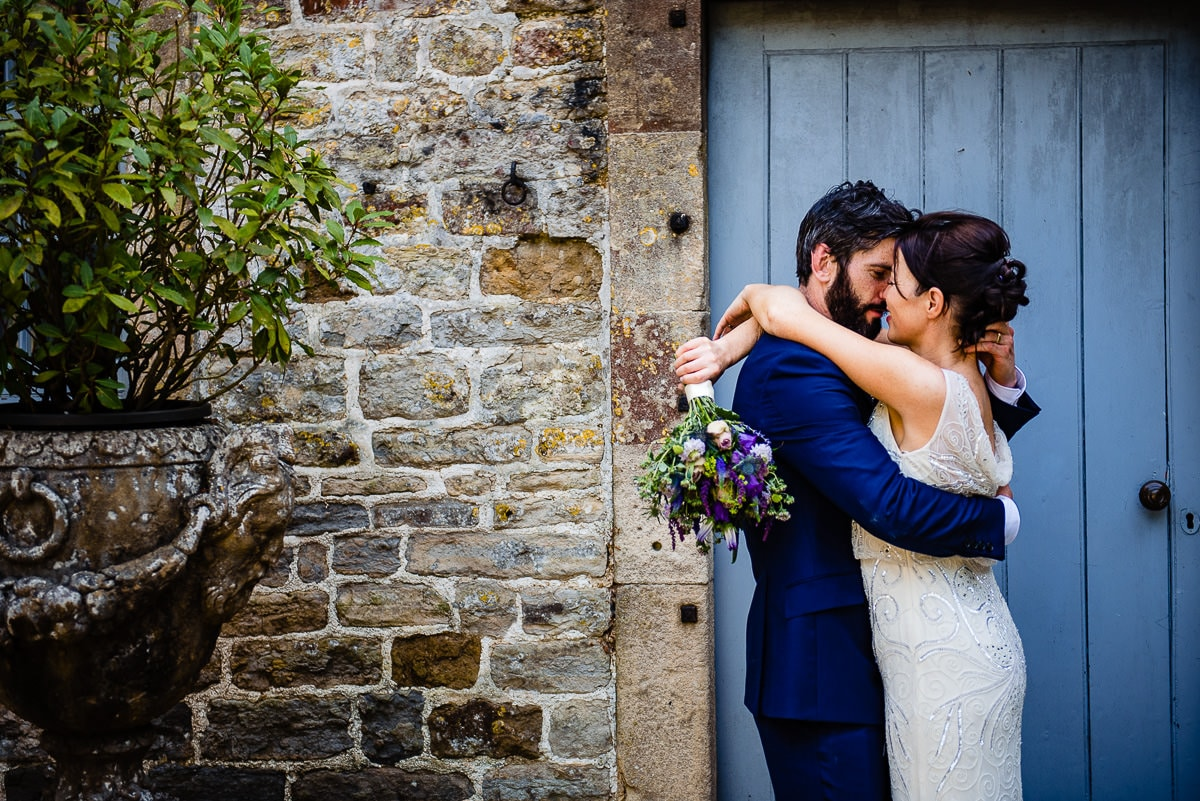 c4dafcdbf11128 bride and groom embrace outside Pennard house. ""