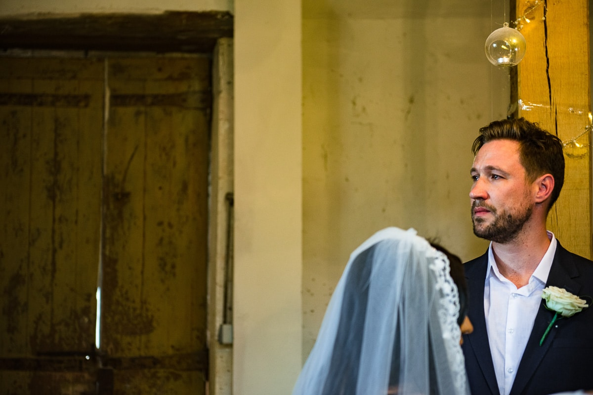 Emotional groom during wedding ceremony at Chateau La Guaterie France