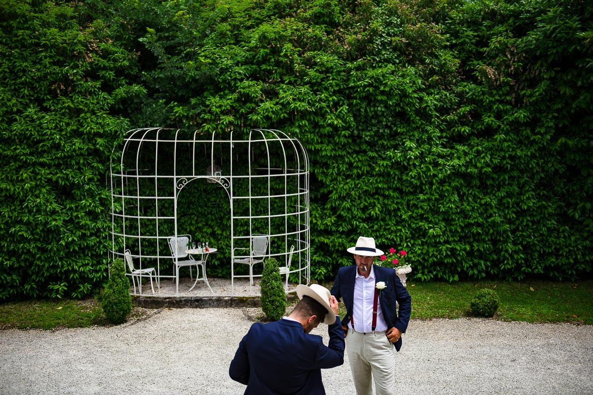 Groomsmen wearing hats documentary wedding photos Chateau La Guaterie