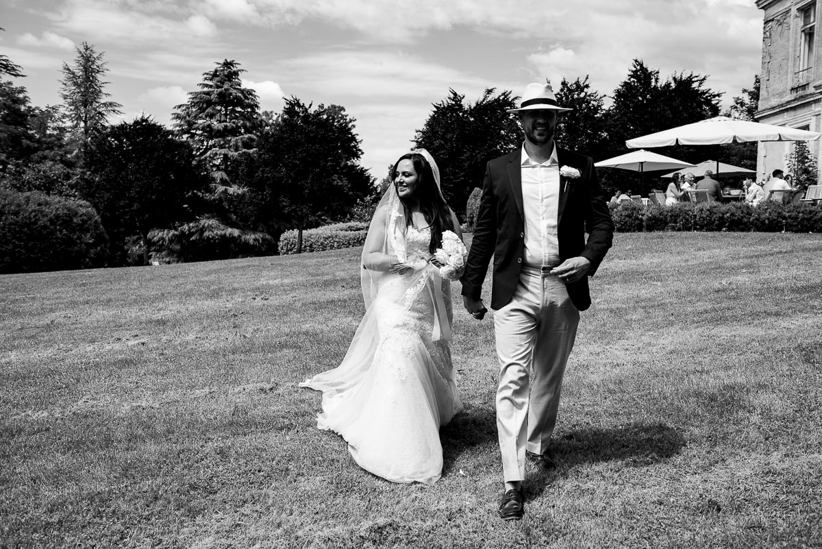 Wedding couple walking in garden at Chateau La Guaterie Saint-Paul-Lizonne