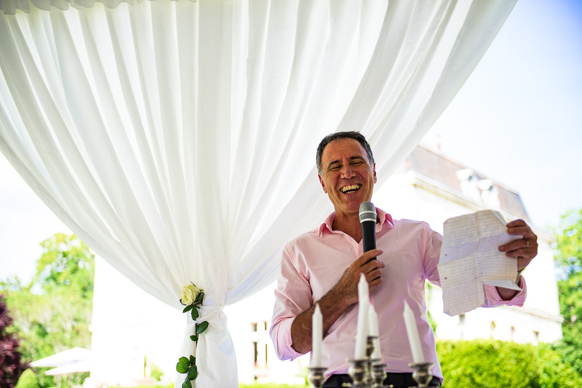 father of the bride reading speech during wedding breakfast
