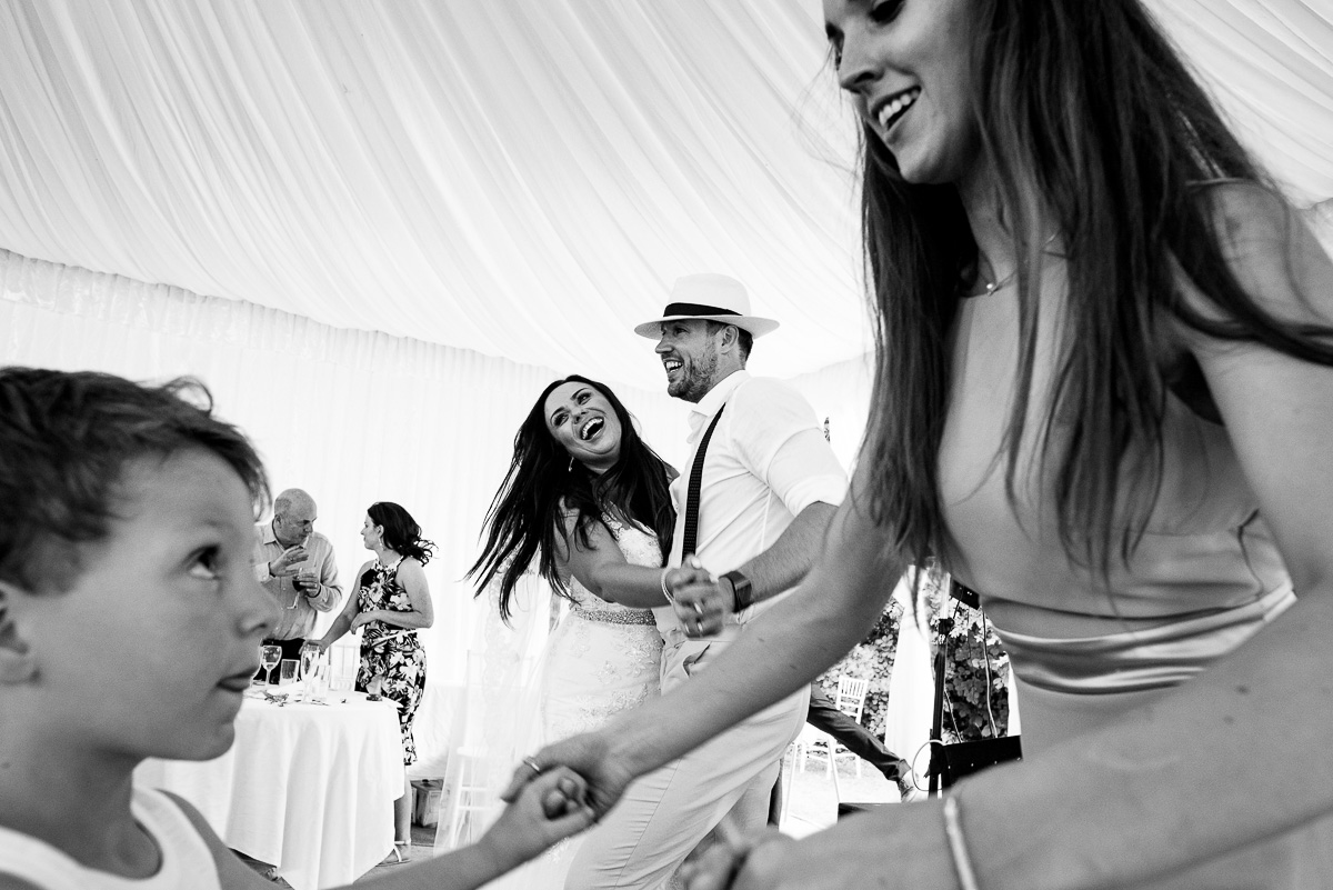 Reportage wedding photos of first dance inside marquee Chateau La Guaterie Dordogne