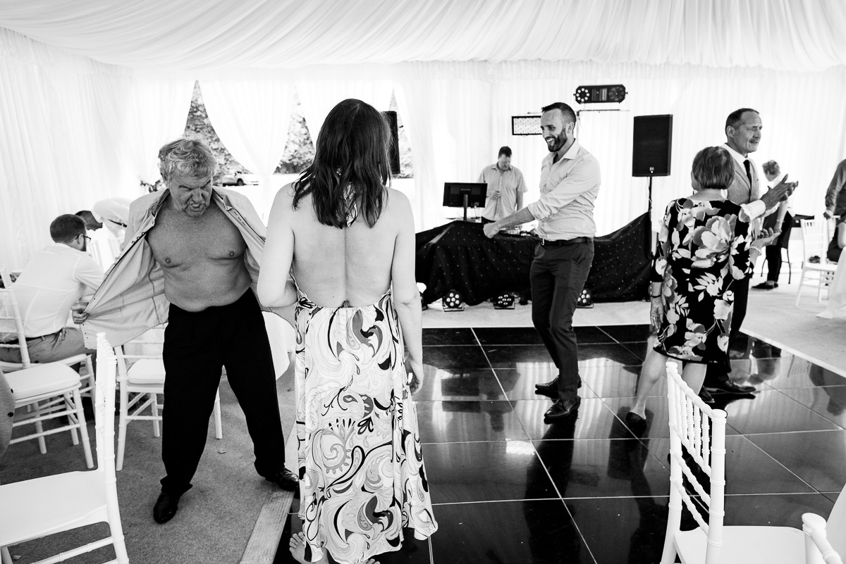 Candid wedding photos of first dance inside marquee Chateau La Guaterie Dordogne