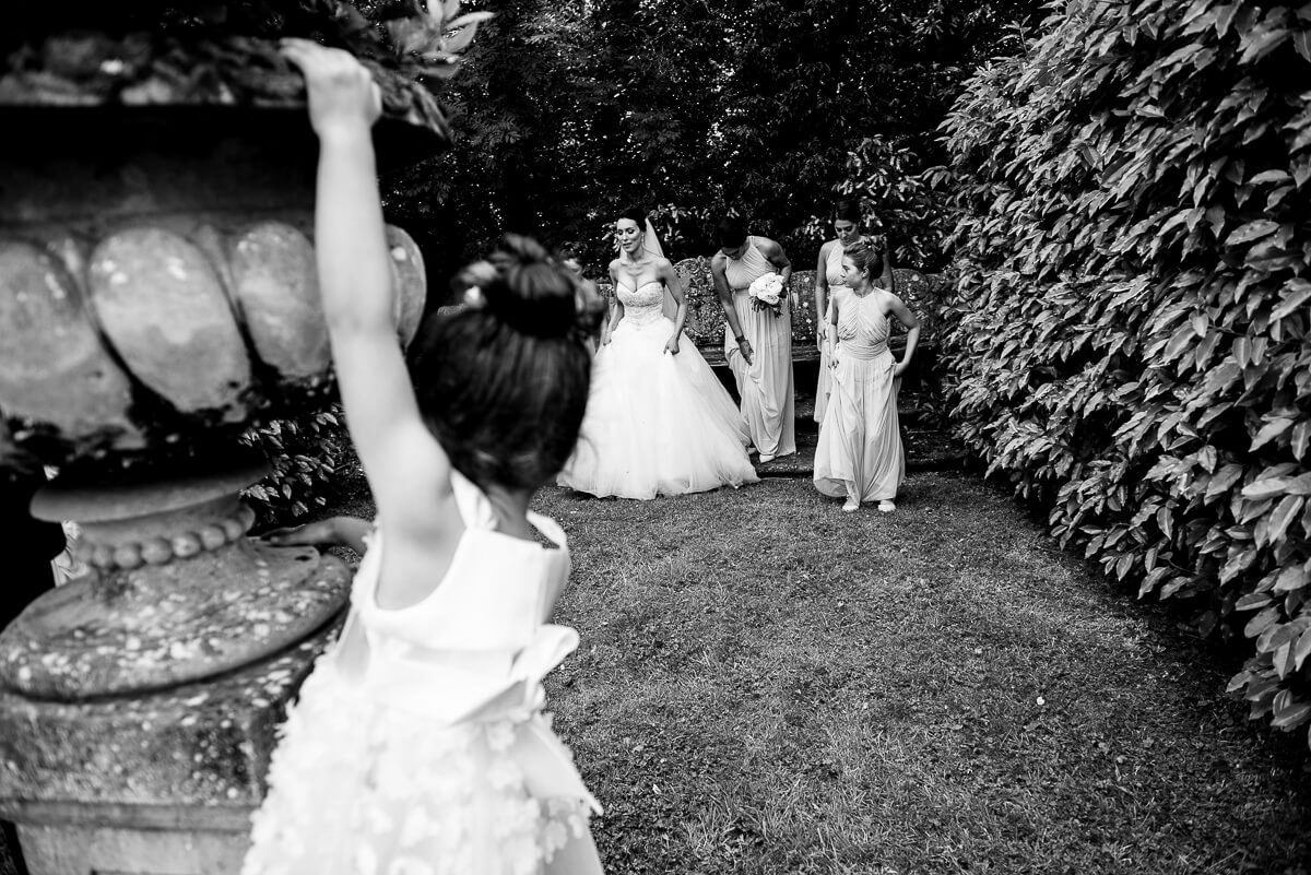 bride and bridesmaids prepare for outdoor photos