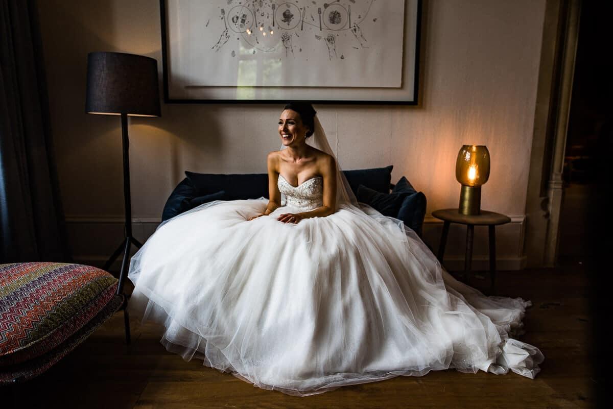 bride sat in sophia tolli wedding dress inside Best Countryside Wedding Venue