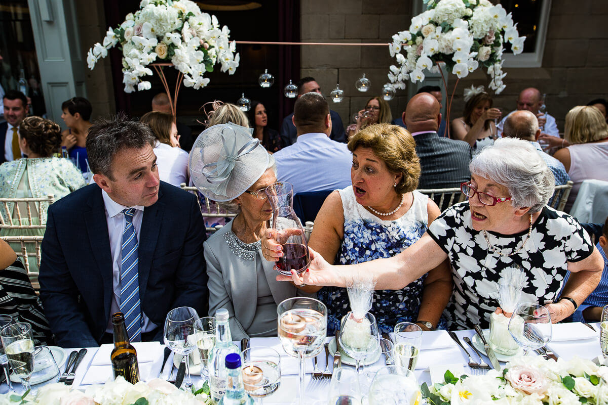 wedding guests sat at banquet table inside hampton manor's Elizabeth Court