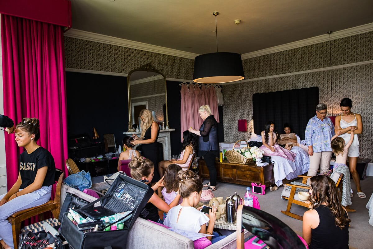 Bridesmaids getting ready for wedding in Hampton manor's bridal suite