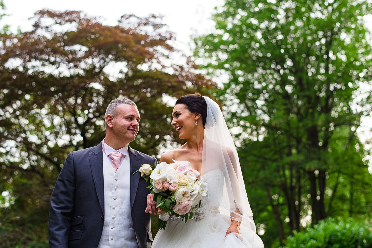 bride and groom take a stroll outside Hampton manor wedding venue