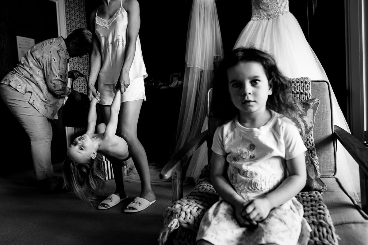 Documentary scene of children waiting in room before wedding ceremony