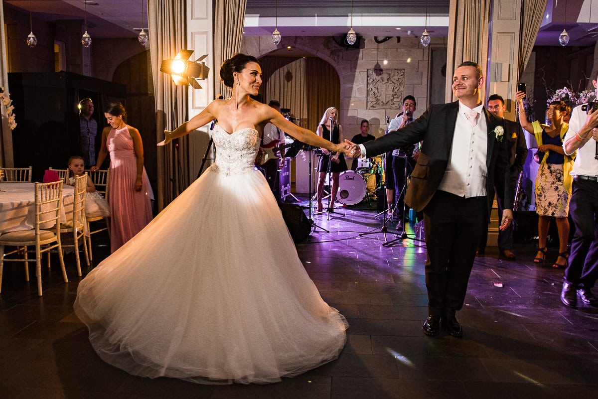 bride and groom use salsa moves to during the first dance