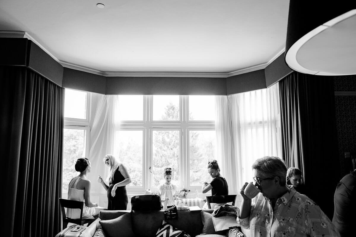 bride being prepared in big bay window in Solihull hotel before wedding