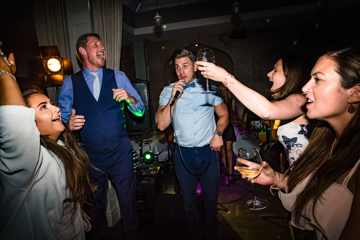 wedding guests party with drinks and karaoke