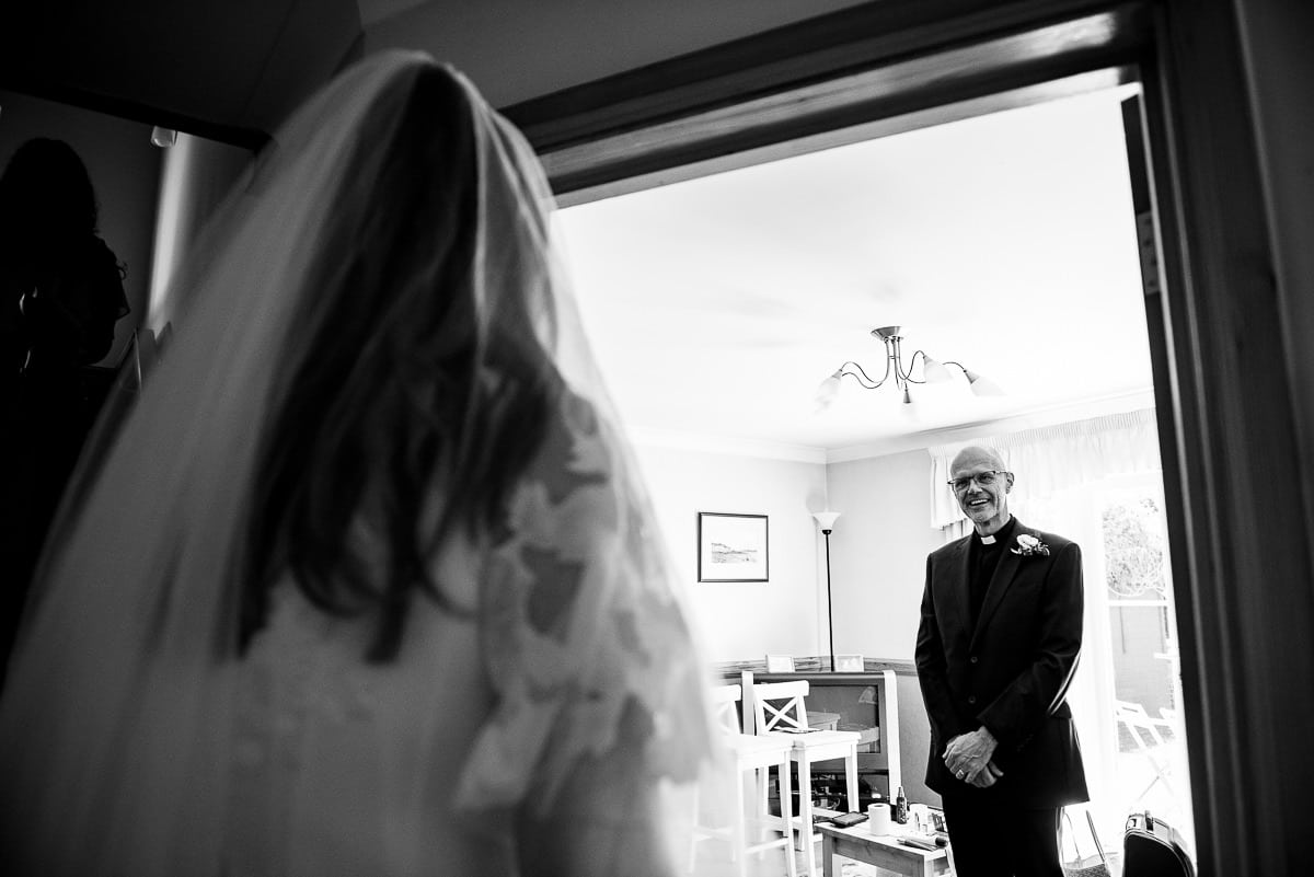 Vicar sees the bride in her wedding dress for the first time