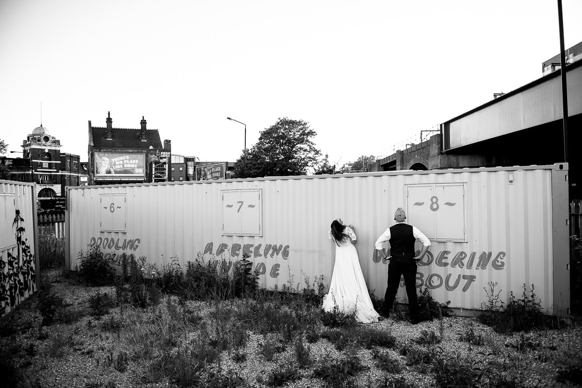 bride and groom by shipping container at alternative London venue