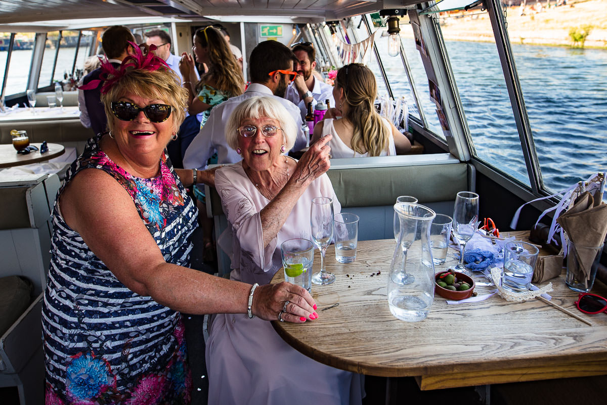 wedding guests point in amazement on board the London party boat