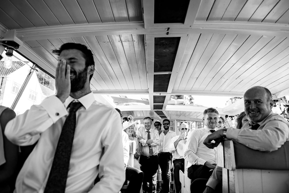wedding guests listen to the speeches on boat