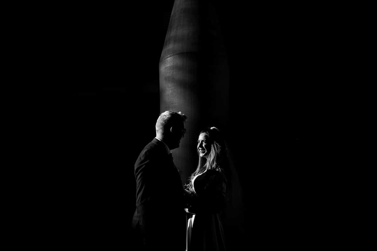 bride and groom in slither of light black and white portrait