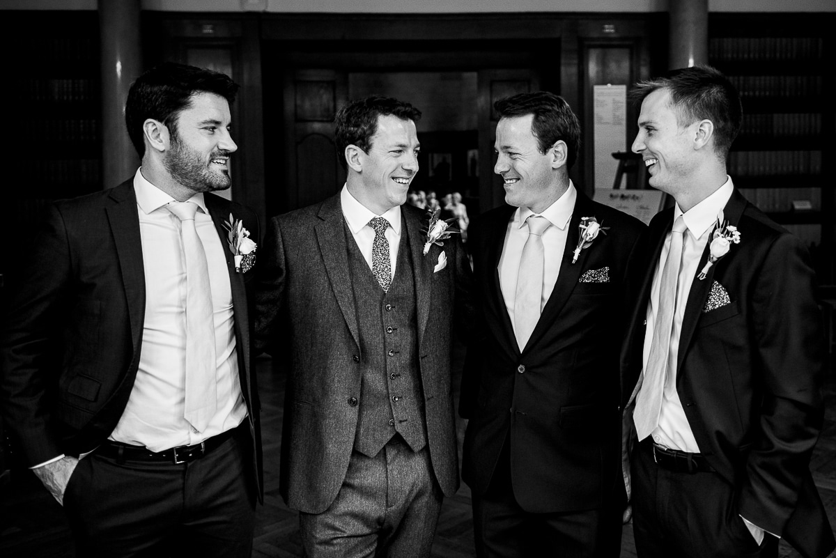 Black and white portrait of the groomsmen in Oxford wedding venue Rhodes House