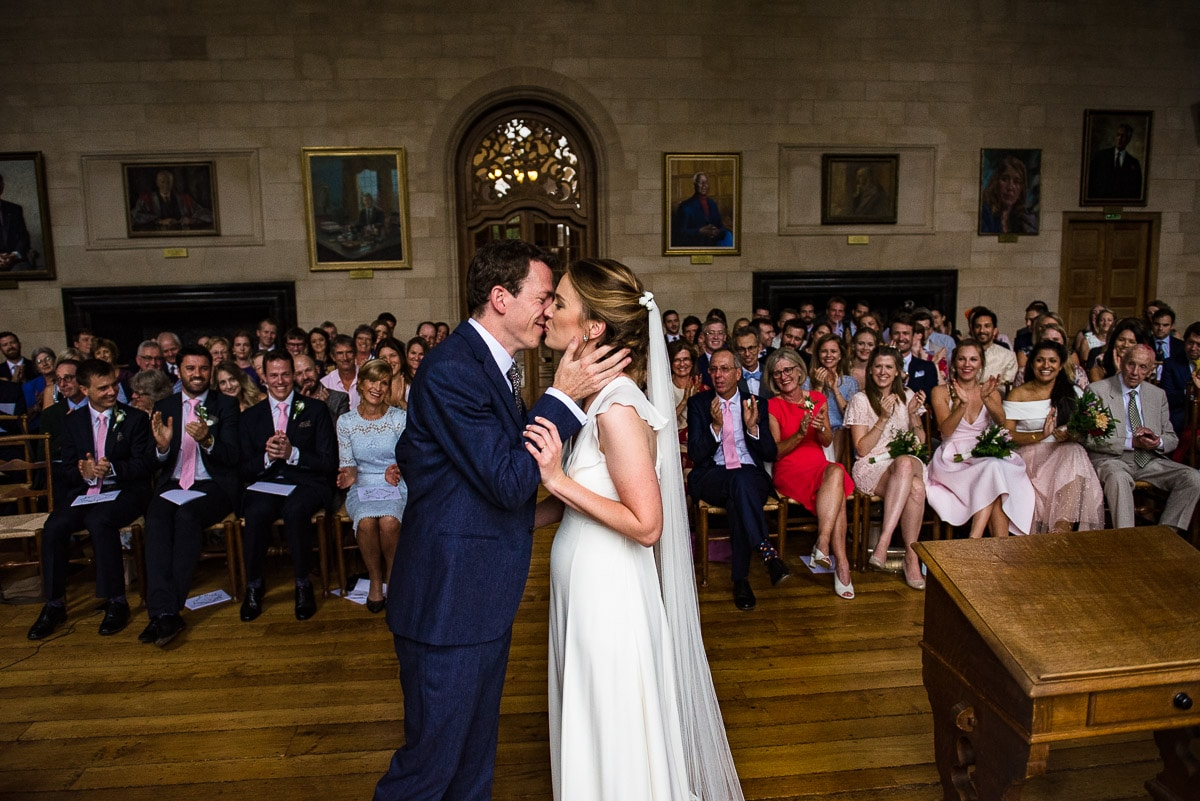 Bride and groom's first kiss wedding ceremony at Rhodes House in Oxford